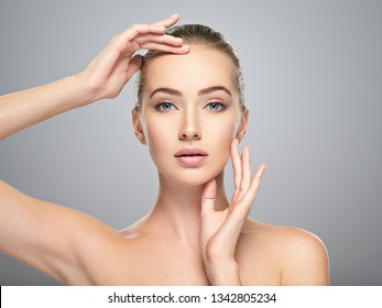 Beautiful face of young caucasian woman with perfect health clean skin.  Skin care treatment. Portrait of an Attractive girl  with blue eyes, closeup. Pretty  and sexy female with stunning look.