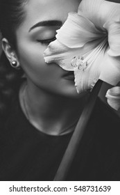 Beautiful Face Of Young Woman With Amaryllis
