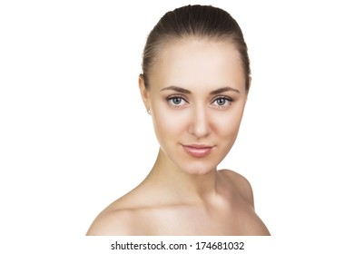 Beautiful Face of Young Woman with Clean Fresh Skin close up isolated on white. Beauty Portrait. Beautiful Spa Woman Smiling