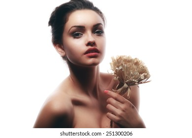 Beautiful face of young  woman with clean fresh skin. Beauty Model Woman Face. Perfect Skin. Professional Make-up.Makeup. Fashion Art.Vogue Style.