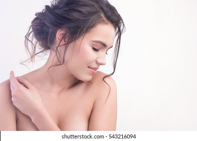 Beautiful face of young woman with clean fresh skin close up isolated on white. Beauty romantic portrait. Spa woman smiling. Perfect fresh skin. Pure beauty model. Youth, cosmetics, skin care concept