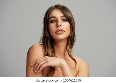 Beautiful face of young woman with perfect health skin