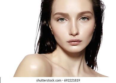 Beautiful Face of young Woman. Skincare, Wellness, Spa. Clean soft Skin, healthy Fresh look. Natural daily makeup, wet hair style