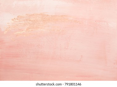 Beautiful faded pink abstract painted paper background texture with shiny metallic golden brush stroke