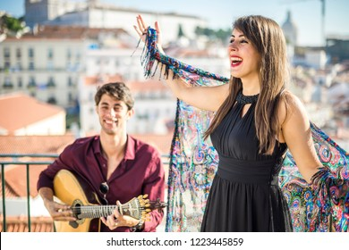 Beautiful fado singer performing with handsome portuguese guitarist player
