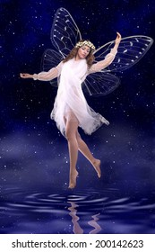 Beautiful fairy dancing above water