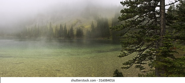 Beautiful Fairy Lake, cloaked in chilly fog.  Located in Montana's Bridger Range, in Gallatin National Forest, near Bozeman and Yellowstone.