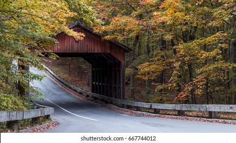 Beautiful fall colors at covered bridge on a scenic drive in Traverse City, Michigan