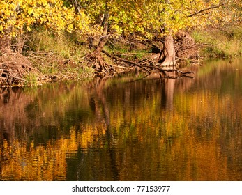 Beautiful fall colors reflect off the Kishwaukee River in Boone County, Illinois