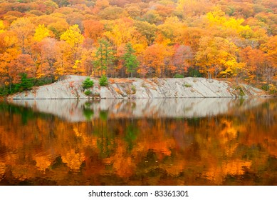 Beautiful fall colors reflecting in the forest lake.