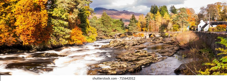 The beautiful Falls of Dochart running through the small town of Killin at autumn. Loch Lomond & The Trossachs National Park, Scotland, UK
