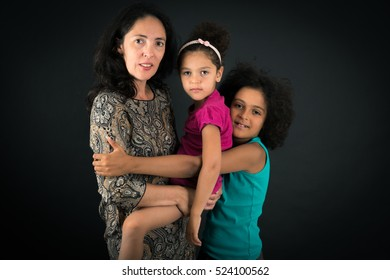 Beautiful family doing different expressions in different sets of clothes: love