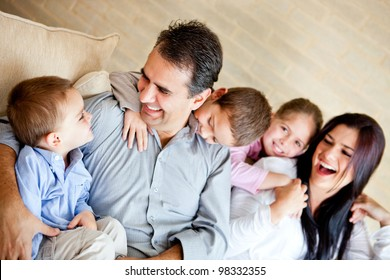 Beautiful family having fun at home sitting on the sofa