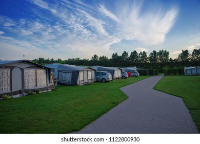 Beautiful family holiday on a campsite. Caravan, campervans and camping cars on a camp site in the nature.