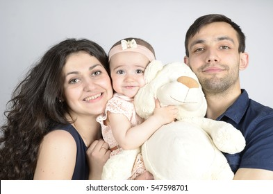 Beautiful family with one year daughter close-up