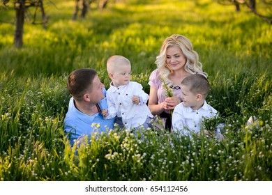 Beautiful family outdoors in a blooming garden