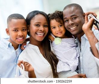 Beautiful family portrait having fun shopping at the mall