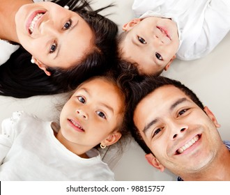 Beautiful family portrait lying on the floor with heads together