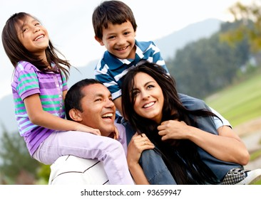 Beautiful family portrait outdoors looking very happy