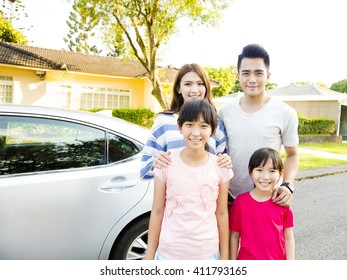 Beautiful family portrait smiling outside their  house