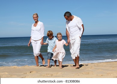 Beautiful family at the seaside in summertime
