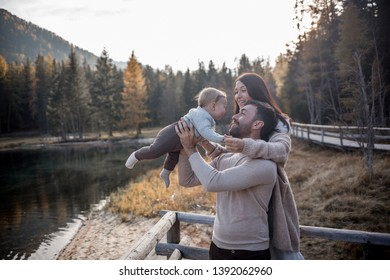 Beautiful family walking near Lake Anterselva in Italy. Image with selective focus and toning