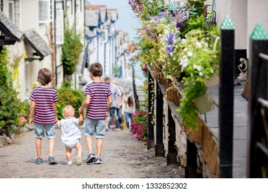 Beautiful family, walking on the streets of Clovelly, nice old village in the heart of Devonshire, England