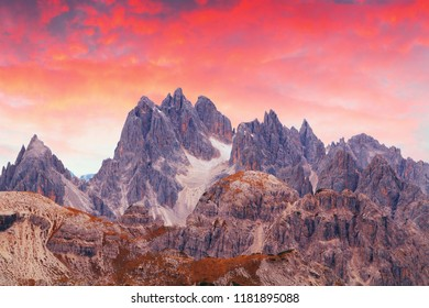 Beautiful and famous Dolomites giant mountains peaks, near Drei Zinnen in the wonderful sunset of South Tyrol, Italy ( Tre Cime di Lavaredo)