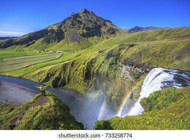 Beautiful and famous Skogafoss waterfall. South of Iceland. Landscape of Skogafoss waterfall