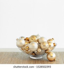 Beautiful, fancy silver and gold Christmas ornaments in glass bowl with white background. Simple, modern, luxe, luxury holiday home interior decor decorations.