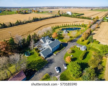 Beautiful farm home surrounded by fields Aerial skyline shot subdivision, neighborhood, restidential