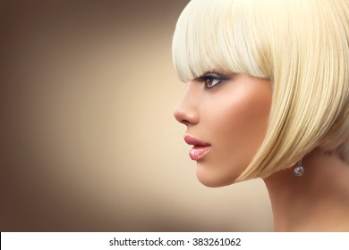 Beautiful Fashion blonde woman with Bob Haircut. Fringe Hairstyle. Dyed white hair. Hairdressing, Perfect makeup. Beautiful Model with Short Blond hair. Model Girl profile portrait on beige background