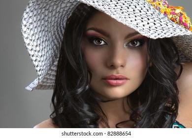 Beautiful fashion girl with retro cap