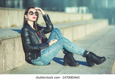 Beautiful fashion hipster trendy girl in sunglasses outdoor
