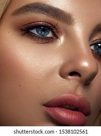 Beautiful Fashion Luxury Makeup, long eyelashes, perfect skin facial make-up. Beauty Blonde model woman holiday make up close up. Eyelash extensions, false eyelashes