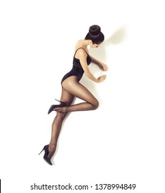 Beautiful fashion model in black swimsuit and hosiery. Young and beautiful woman posing in studio.