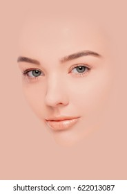 Beautiful fashion model girl face pink mask makeup creative concept portrait on black background