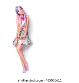 Beautiful Fashion model Girl full length portrait, in short colourful white dress and very long colorful hair, dyed blonde hair. Beautiful young woman posing in studio, isolated on white background