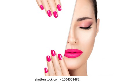 Beautiful fashion model girl with pink smoky eye, foundation on a perfect skin and trendy pink lipstick to match her manicured nails, half face with white card template. High fashion portrait isolated