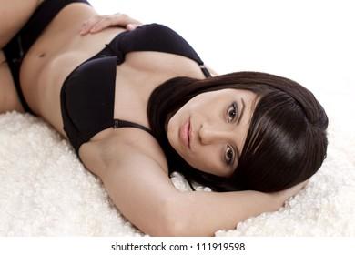 Beautiful fashion model in lingerie in bed