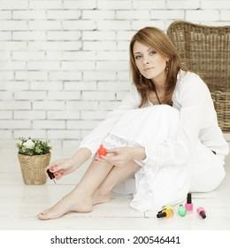 Beautiful fashion model and nail polish