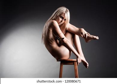Beautiful fashion model naked in studio