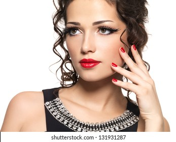 Beautiful fashion model with red manicure and lips - isolated on white background
