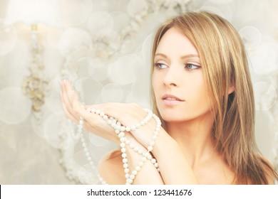 Beautiful fashion model in royal interior, portrait