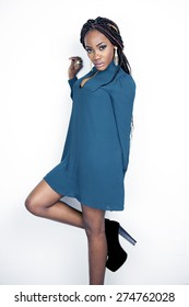Beautiful fashion model in a teal dress
