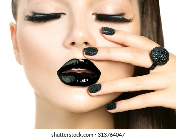 Beautiful Fashion Model woman with Long Lashes and Black make up isolated on white. Fashion Trendy Caviar Black Manicure. Nail Art. Dark Lipstick and Nail Polish. Vogue style
