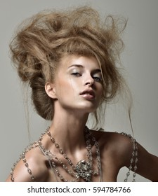 Beautiful fashion model woman with magnificent hairstyle. Great decoration, jewelry body Chain