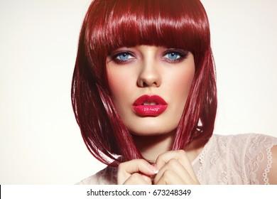 Beautiful fashion redhead girl with bob haircut and stylish make-up