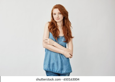 Beautiful fashion redhead model posing smiling looking at camera.