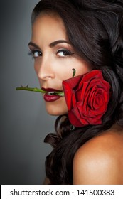 Beautiful Fashion Woman with bright makeup and red Rose. Hairstyle